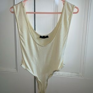 Yellow plunge body suit